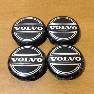 4 Negro RUEDA llantas de aleación Centro Tapacubos Logo insignia del emblema de 64mm para Volvo: Amazon.es: Coche y moto