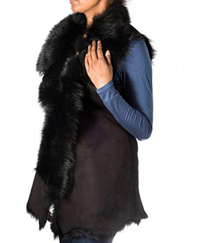 Aux femmes. Daim noir avec peau de mouton noire. Gilet / Waistcoat de chasse d'eau de fourrure (chauffe-corps sans manches)