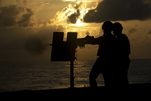Home Comforts A Sailor fires a .50-caliber machine gun during a live-fire exercise aboard the amphibious transpor by Home Comforts