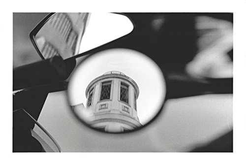 Surprising reflection of a building in the mirror of a motorcycle. Black and white analog photography by Julio Erre Photos&Painting