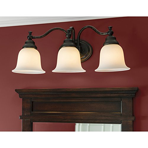 outlet portfolio 3 light brandy chase oil rubbed bronze bathroom vanity light. Black Bedroom Furniture Sets. Home Design Ideas