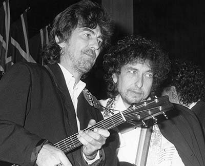 Photo Musicians George Harrison Bob Dylan at Rock & Roll Hall of Fame.