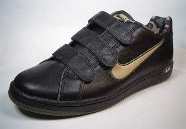 Nike - Zapatillas de cuero y tela para hombre Negro schwarz-gold 41