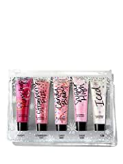 The gift of gloss. This clear totable pouch holds five best-selling Flavor Glosses, each a delicious kiss of sheer color and next-level shine. Shine on with Candy Baby, Strawberry Fizz, Sugar High, Punchy and Iced.  GIFT INCLUDES:Candy Baby: ...