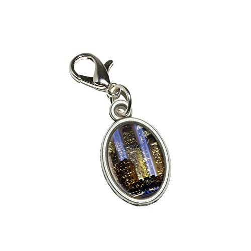 (Graphics and More New York City Skyline Sky Lights Antiqued Bracelet Pendant Zipper Pull Oval Charm with Lobster Clasp)