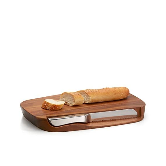 Nambe Blend Bread Board with Knife, Brown 2 BEAUTIFUL FUNCTIONALITY: The Blend Bread Board lives up to its name by transitioning seamlessly from preparing to entertaining, and back again. The bread knife fits conveniently into the side, so you can slice as the night goes on keeping each piece as fresh as the last. STRONG ELEGANCE: The stainless-steel knife provides you with swift and efficient bread slices, saving preparation time for entertaining. It cuts through baguette easily without marring the beautiful Acacia wood of the board, so you can use it for dinner party after dinner party. NEIL COHEN ORIGINAL: Meet Neil Cohen, who creates some of Nambé's most popular and wondrously beautiful designs in metal, crystal and lighting, and has a ton of fun in the process. His work supplies the kind of spark that engages the human spirit.
