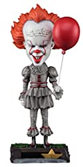 "From the acclaimed 2017 horror film IT, drawn from the pages of Stephen King's original novel, this Pennywise Head Knocker stands over 8"" tall with bobbling head. The killer clown is cast in resin and then hand painted for chilling detail, do..."