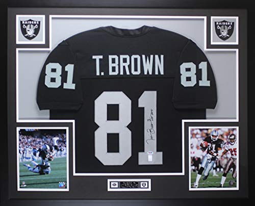 (Tim Brown Autographed Black Raiders Jersey - Beautifully Matted and Framed - Hand Signed By Tim Brown and Certified Authentic by PSA - Includes Certificate of Authenticity - Inscribed HOF 2015)