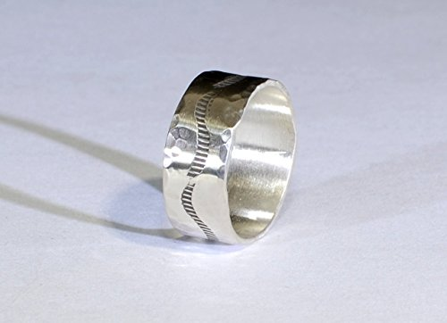 (sterling silver ring band with southwestern stamp design)