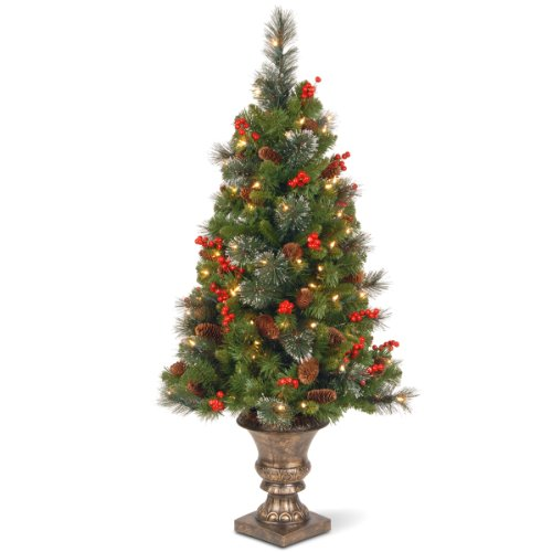National Tree 4 Foot Crestwood Spruce Entrance Tree with Cones, Glitter, Red Berries, Silver Bristle and 100 Clear Lights in Decorative Urn - Christmas Topiary