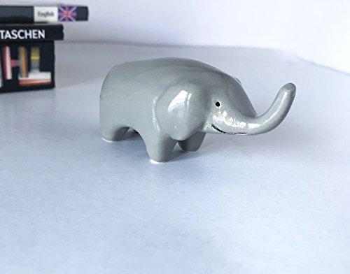 Hand Shaped Ceramic Miniature Elephant Figurine