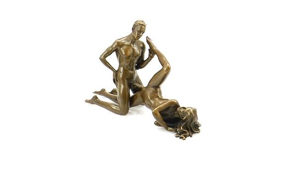 Erotisk guld dame figur