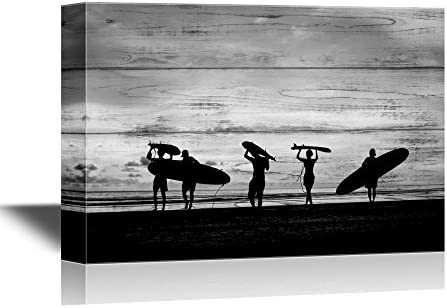 Water Entertainment Silhouette of Surfer People Carrying Their Surfboard on Sunset Beach