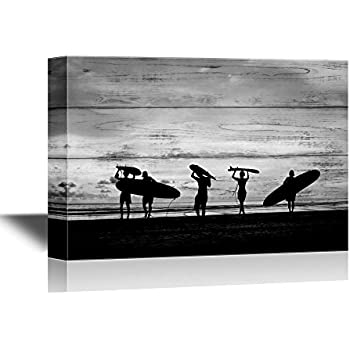 wall26 - Water Entertainment Canvas Wall Art - Silhouette of Surfer People Carrying Their Surfboard on Sunset Beach - Gallery Wrap Modern Home Decor | Ready to Hang - 24x36 inches