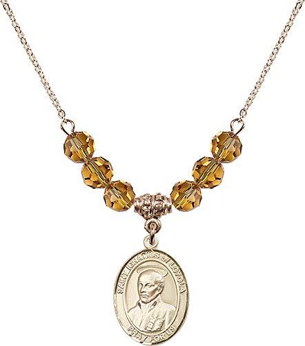 Bonyak Jewelry 18 Inch Hamilton Gold Plated Necklace w/ 6mm Yellow November Birth Month Stone Beads and Saint Ignatius of Loyola ()