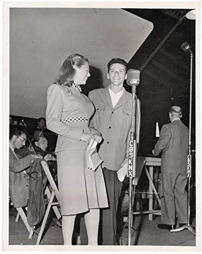 FRANK SINATRA with DINAH SHORE at a WWII Bond Rally October 1944; an original publicity press photograph. The photograph measures 7