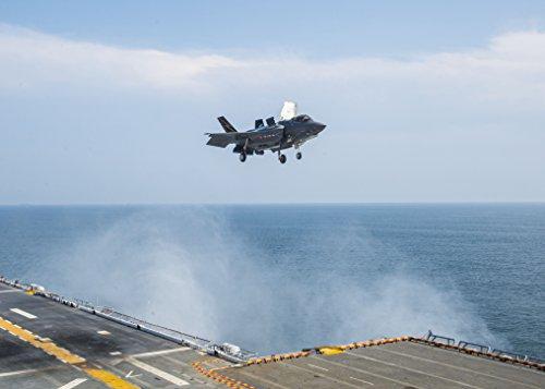 A Lockheed F-35B Lightning II aircraft approaches the U.S. Navy amphibious assault ship USS Wasp (LH