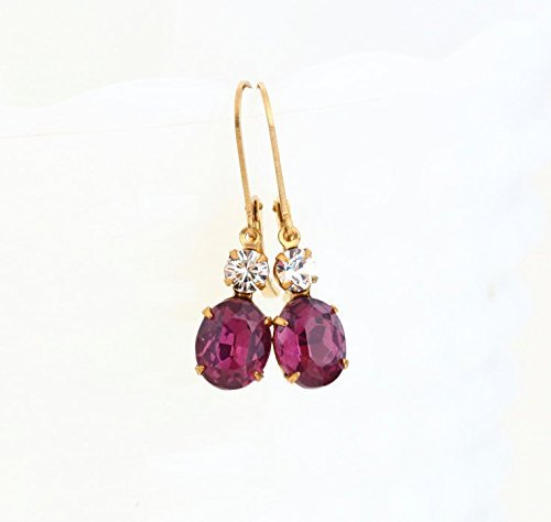 Purple glass jewel earrings with gold plated ear wires.