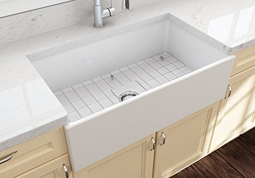 Contempo Farmhouse Apron Front Fireclay 33 in. Single Bowl Kitchen Sink with Protective Bottom Grid and Strainer in White - Fireclay Apron Sink