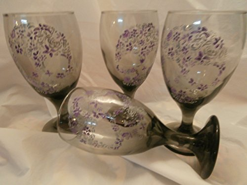(Hand painted sugar skulls in lavender and gray. set of 4 short stemmed smoke ice tea glasses..)