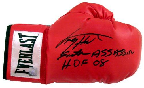 "Larry Holmes Signed Boxing Glove ""Easton Assassin HOF 08"" Inscription"