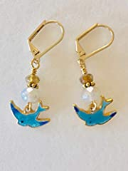 Adorable petite Guilloche blue bird charm earrings. Dainty vintage Sarah Coventry enameled blue bird charms from the 1950's/1060's. These gorgeous little birds have been enameled in the old fashioned method called Guilloche. The blue colors a...