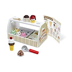Scoop up some cool treats with this all-inclusive, 28-piece pretend play ice cream counter! The sturdy wooden tabletop counter holds eight wooden scoops of different-flavored ice cream, six assorted toppings, two cones, a plastic cup, an ice ...