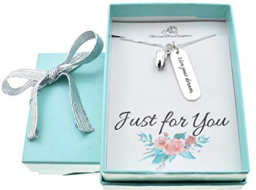 Live Your Dream necklace in sterling silver with sterling silver tooth charm suspended from an 18
