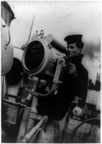 Photo: Terror of U-boats,men of a British Corvette crew,sending signal by searchlight