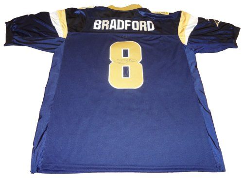 (Sam Bradford Autographed St. Louis Rams Blue Jersey W/PROOF, Picture Of Sam Signing For Us, Oklahoma Sooners, NFL Rookie Of The Year, Heisman Trophy Winner)