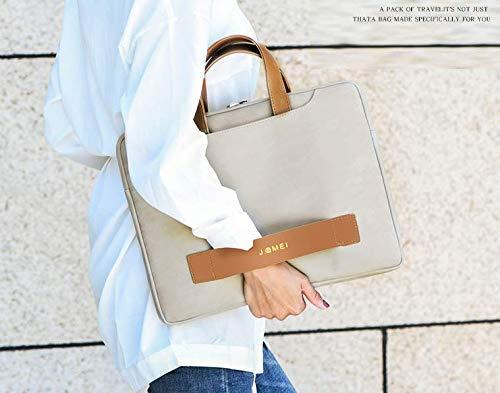 レディースにおすすめなツートンカラーのフェイクレザーパソコンバッグを持った女性の画像