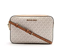 Boasting the MK signature design on canvas and a convenient adjustable strap, this bag lends you super-sophisticated and functional style while on the go.
