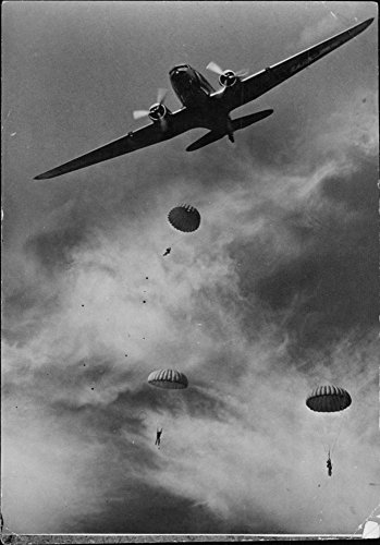 Vintage photo of United States parachute troops leaving their plane in maneuvers somewhere in the - Parachute States United