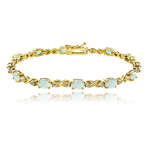 Gold Opal Bracelet (Yellow Gold Flashed Sterling Silver Simulated White Opal 6x4mm Oval Infinity Bracelet with White Topaz Accents)