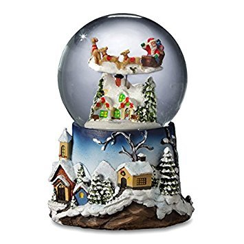 Santa Flying Over Village Snow Globe by The San Francisco Music Box Company