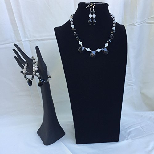 Stunning handmade jewelry set with a necklace, two bracelets and matching dangle earrings. Black and white mixed gemstones. One of a kind by The Stonz Project