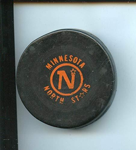 - 1970's Minnesota North Stars Game Used Hockey Puck LOA Willie Brossart - Game Used NHL Pucks