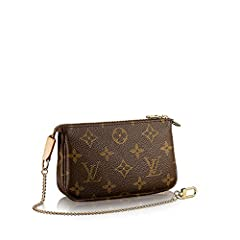 Playful and compact, the Mini Pochette Accessoires in Monogram canvas is a delightful way to carry those essentials. It can be attached to other bags or simply carried on its own.