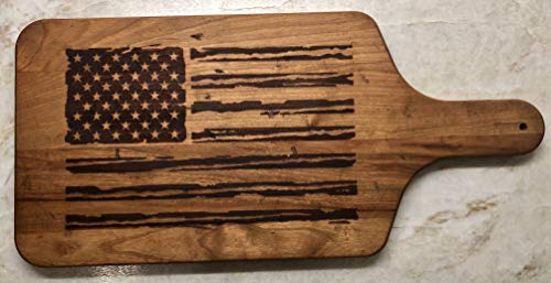 """Laser Engraved American Flag Cherry Hardwood Cutting Board With Handle. Great for entertaining. Makes the perfect gift. Hand distressed and""""antiqued"""" to achieve a vintage look. 17 x 8 x.75 inch"""