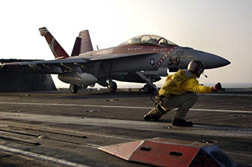 Home Comforts A catapult shooter gives the launch signal to an F/A-18F Super Hornet, assigned to the Diamondback