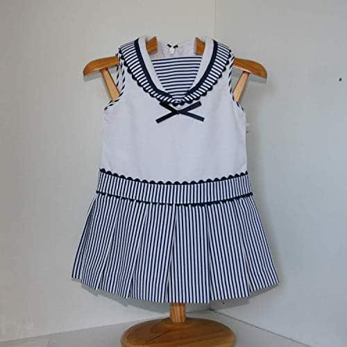 Vestido marinero en pique blanco y marino Talla 9 meses.