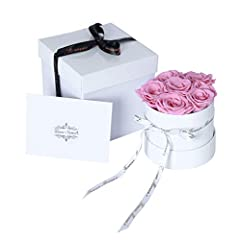 Forever Monroe's Signature Small Round White Box is filled with 6-8 carefully picked Preserved Pink Roses. The preserved rose has undergone a special treatment where the water inside the rose is replaced with a special preservative so it can ...