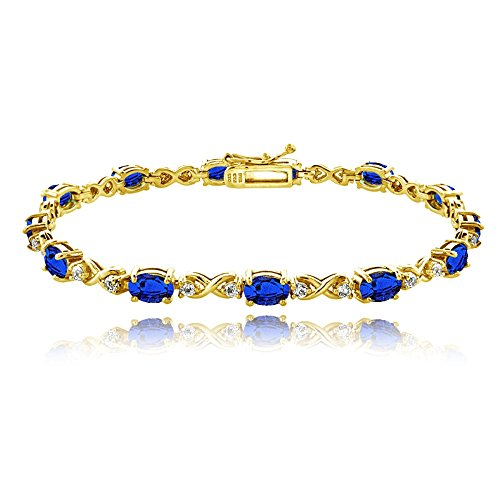 GemStar USA Yellow Gold Flashed Sterling Silver Created Blue Sapphire 6x4mm Oval Infinity Bracelet with White Topaz Accents