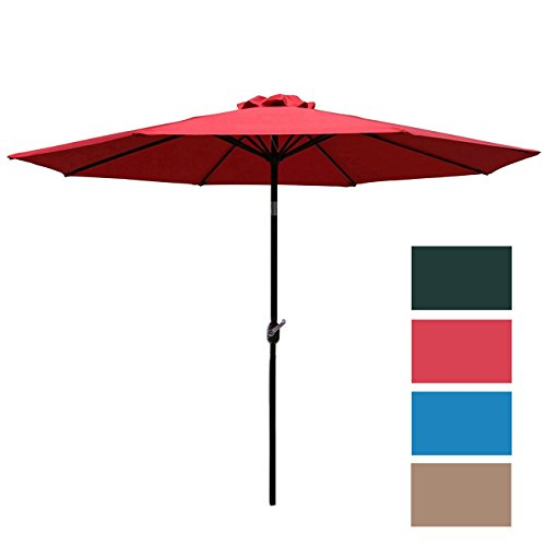 The traditional type of patio umbrella in red an other colours such as brown, blue an dark green.