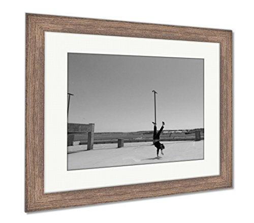 Ashley Framed Prints Man Handstands On Top of A Parking Garage The City of Portland M, Wall Art Home Decoration, Black/White, 26x30 (Frame Size), Rustic Barn Wood Frame, AG6503962