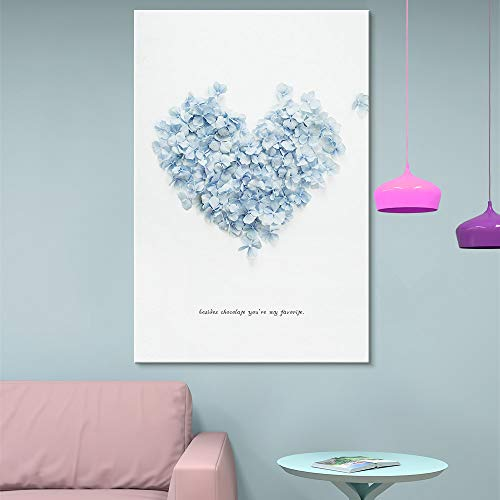 Heart Shaped Formed by Sky Blue Petals on White Background