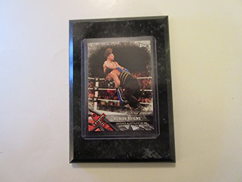 Roman Reigns Extreme Rules Topps WWE 2017 defeats AJ Styles in an Extreme Rules match card mounted on a 4