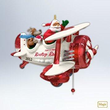 Hallmark Keepsake Ornament Santas Rooftop Racer Santa in Biplane 2012