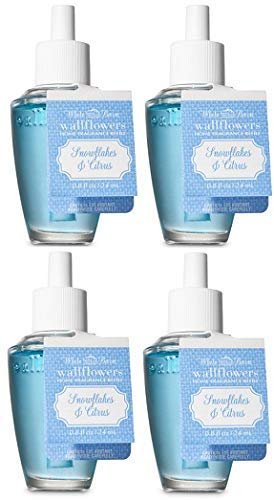 Bath and Body Works Snowflakes and Citrus Wallflowers Fragrances Refill. 0.8 Oz. 4 Set.