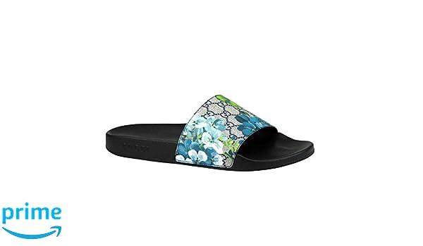 0058af0e864 Amazon.com  Gucci Bloom Print Blue Supreme GG Canvas Flower Slide Sandals  407345 8498 (14 G   15 US)  Shoes